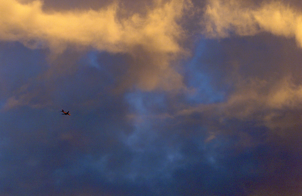 An airplane flies into Charlette Tuesday evening.